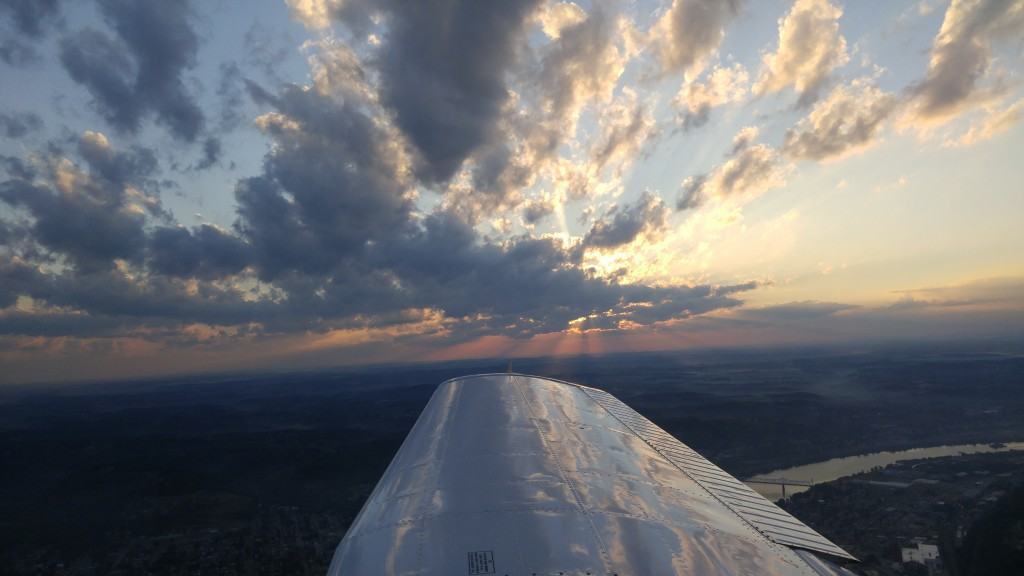 Sun breaking through the clouds off the right wing