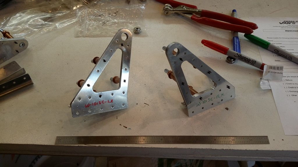 Left and right outboard aileron bearing brackets